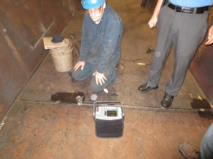 A worker conducting ultrasonic testing